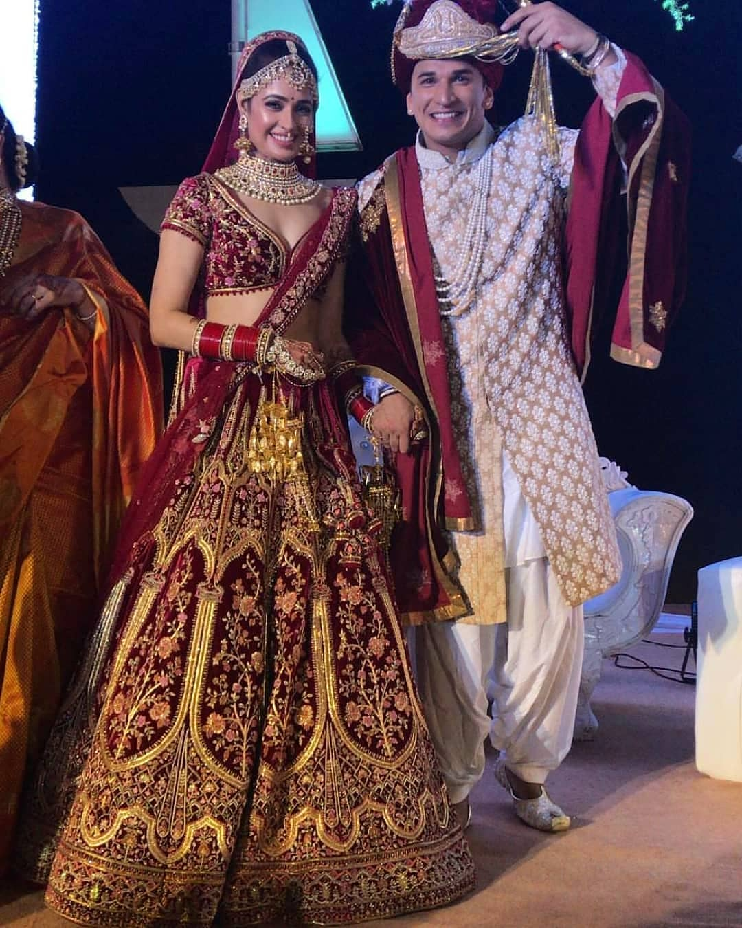 Beige and maroon combination: Bride and Groom Wedding Dress Colour Combinations