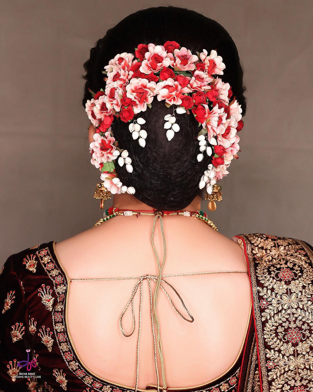 The magic of red and white: Bridal Bun Hairstyles with Flower Jewellery