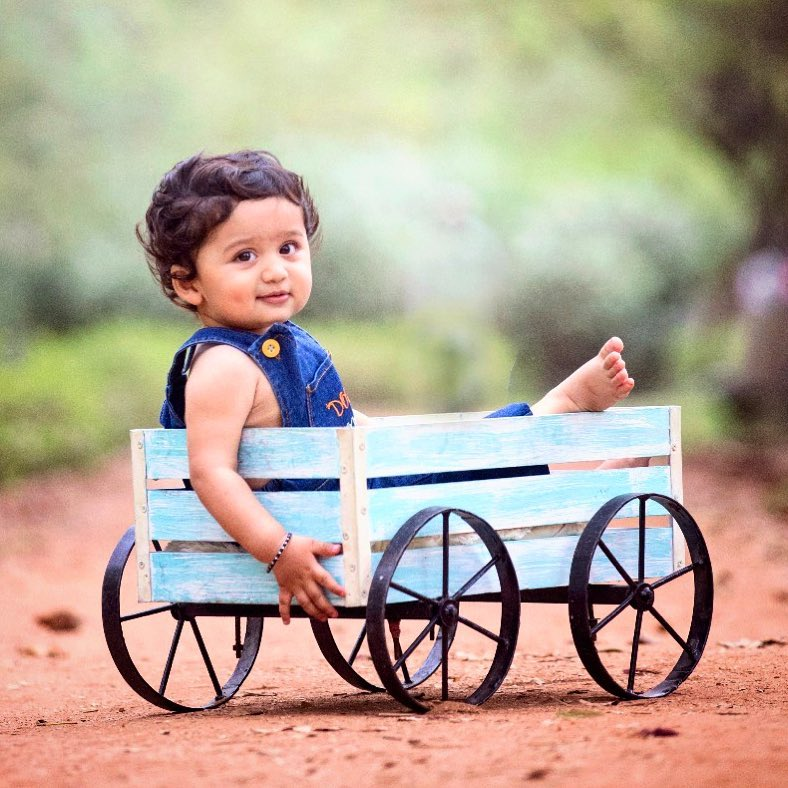 Baby in a fruit basket: Child photography poses ideas for memorable photoshoot