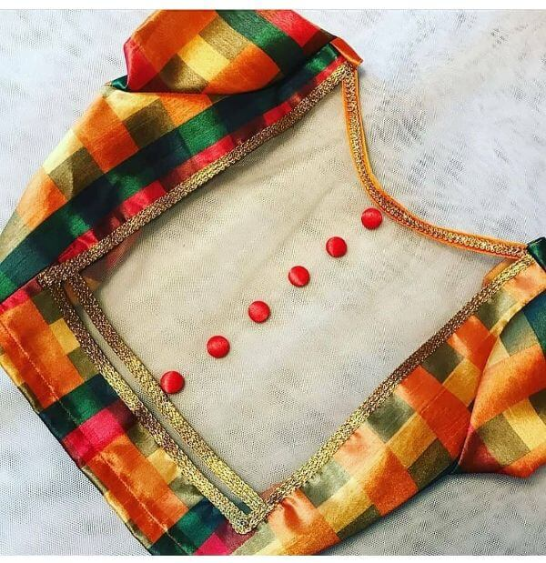 The coloured mosaic blouse with sheer back Fancy Saree Blouse Back Neck Designs for Indian Women