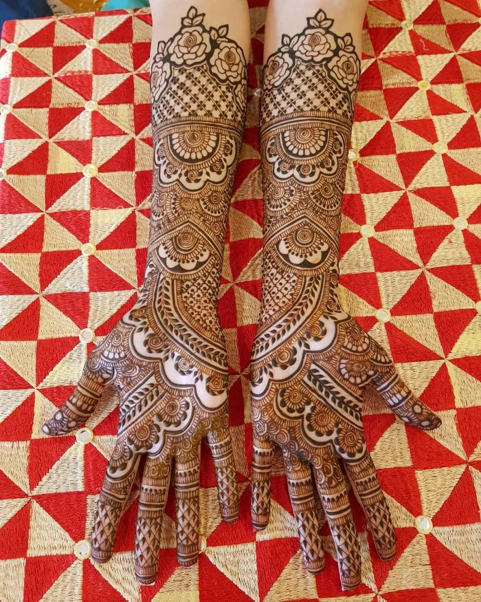 Beautiful roses and semi circles based bridal mehndi design for hands Bridal Front Hand Mehndi Designs from Shainaaz Mehendi