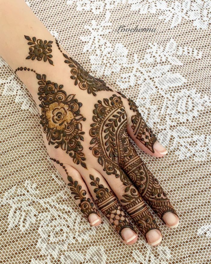 Rose and motif mehndi designs for back hand for bride Mehndi Designs for Back Hand from Farah Saye