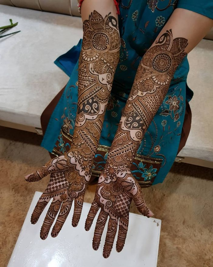 . Beautiful and long bridal mehndi design for hands Bridal Front Hand Mehndi Designs from Shainaaz Mehendi
