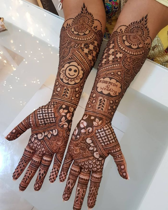 Beautiful smiley and names bridal mehndi design for hands Bridal Front Hand Mehndi Designs from Shainaaz Mehendi