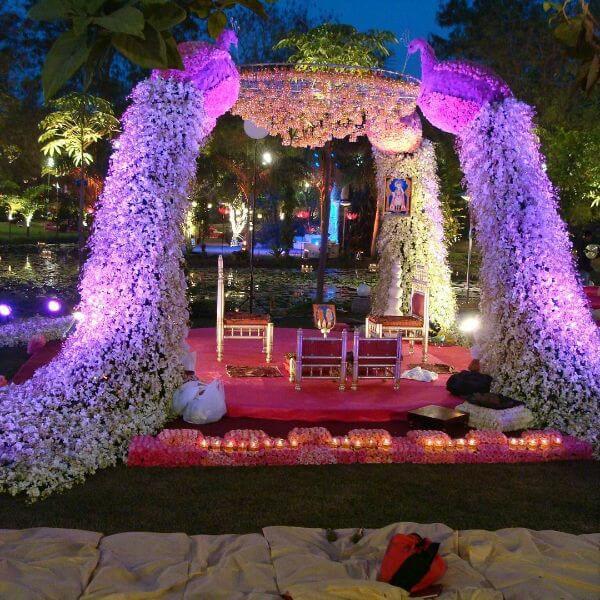 Beautiful peacock pillarsMandap with lights and flowers
