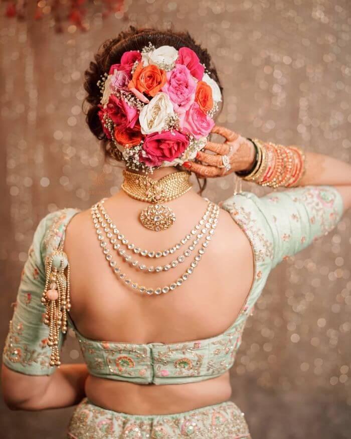 Ornated flower bun designer hair Dressing Tips from Anushka Sharma's Fashion Style