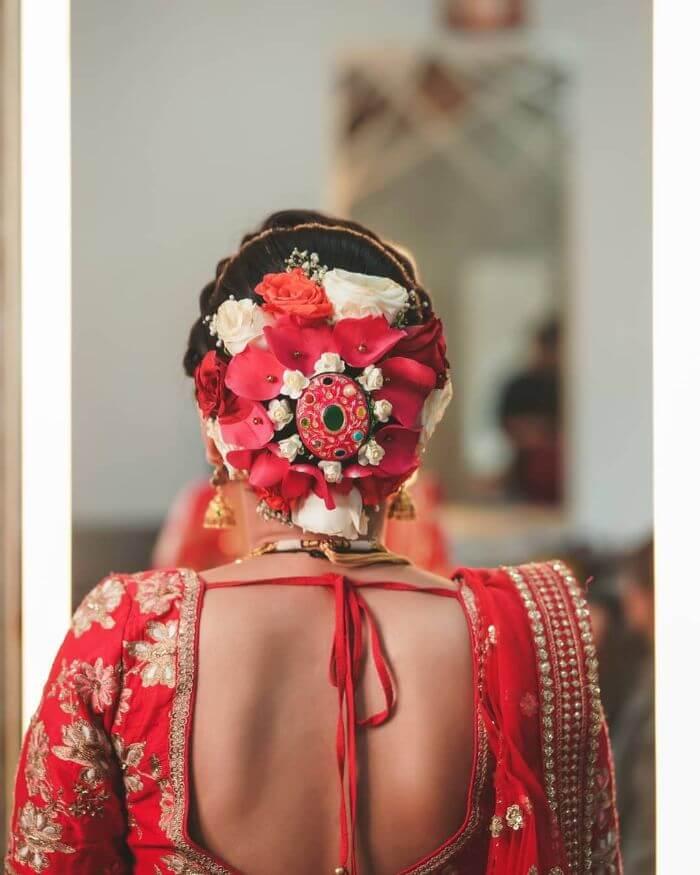 The beautiful centre piece flower bun design Bridal Floral Bun Hairstyles for Wedding Day
