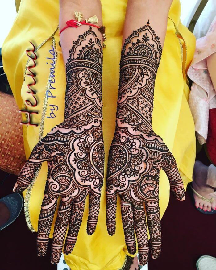 Bridal full hand mehndi design with central puzzle piece Bridal Full Hand Mehndi Designs for Wedding Day