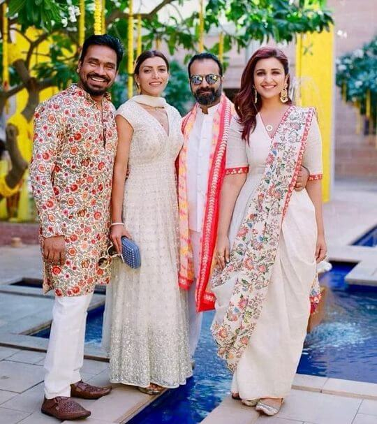 Bollywood actress Parineeti Chopra in wedding outfit Fusion saree gown
