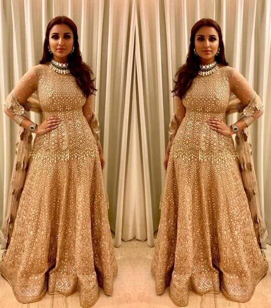 Bollywood actress Parineeti Chopra in wedding outfit Pink beige lehenga