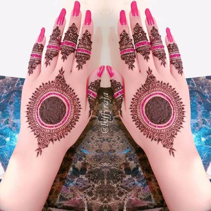 Beautiful pink glitter mehndi design for hands  Glitter Mehndi Designs for Hands by Hiffyraja