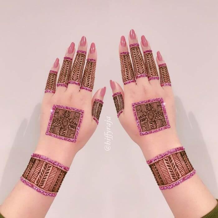 Modern Purple glitter mehndi design for hands Glitter Mehndi Designs for Hands by Hiffyraja