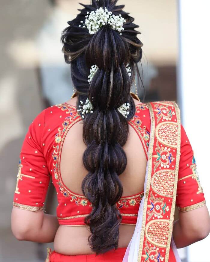 Beautiful high rise Indian Wedding hairstyle Indian Wedding Hairstyles for Long Hair