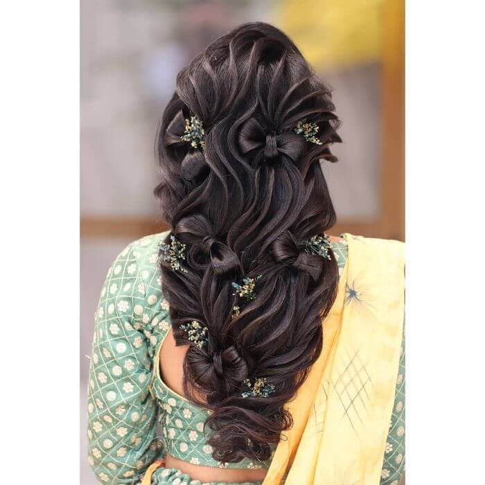 the bow ties hair knot wedding hairstyle for long hair Indian Wedding Hairstyles for Long Hair