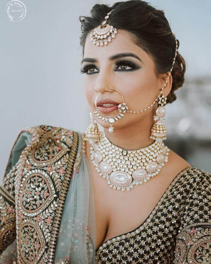 A nath with a stones and a drop Latest Bridal Nath Designs for Traditional Indian Wedding