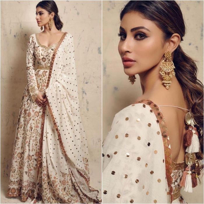 Beautiful embroidered white long suit and golden big earrings Mouni Roy Dresses that are Perfect for Bridesmaids