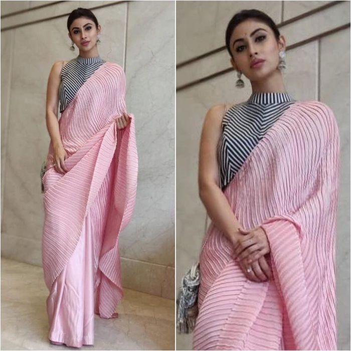 Mouni Roy drapped plain and elegant pink saree and black blouse with Silver Jhumki