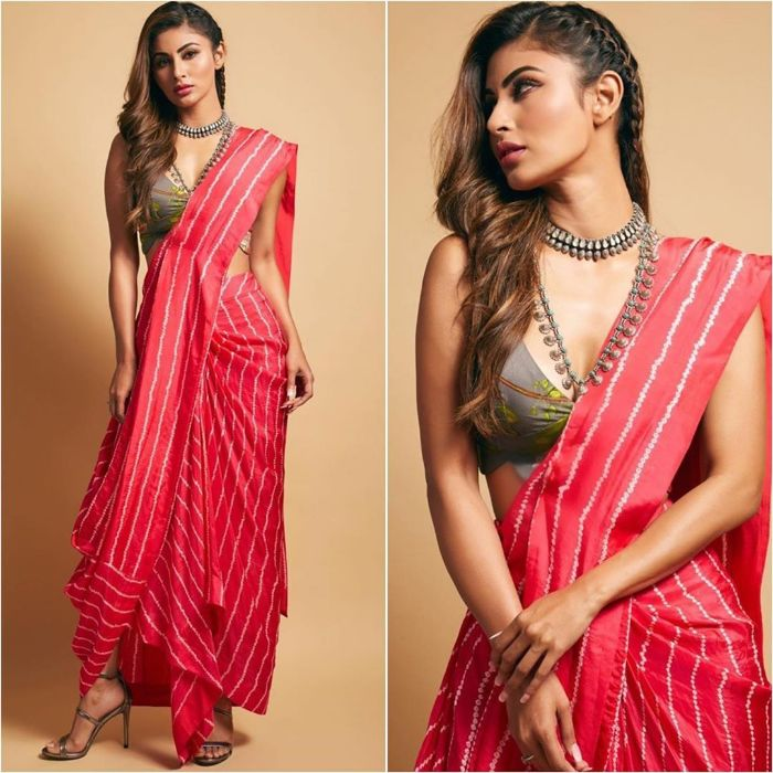 "Mouni roy wearing a edged red drapped saree with grey printed sleeve blouse  by "" npurkanoi"" - K4 Fashion"