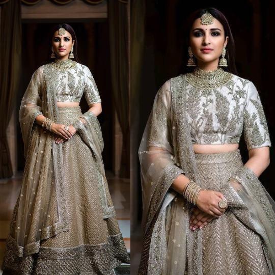 Bollywood actress Parineeti Chopra in wedding outfit Ivory and grey lehenga
