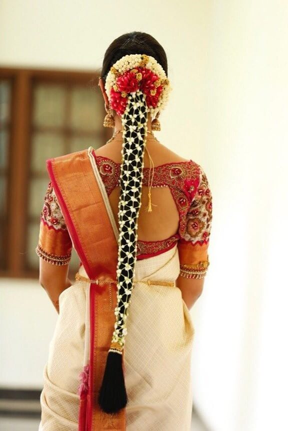 Long braid with floral adornation Trendy Hairstyles for Long Hair | Wedding Special