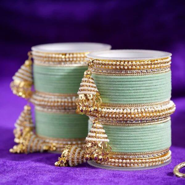 Latkan adorned beautiful Indian Bangle Set Trendy Bangle Designs for Indian Brides to Make Your Wedding Memorable