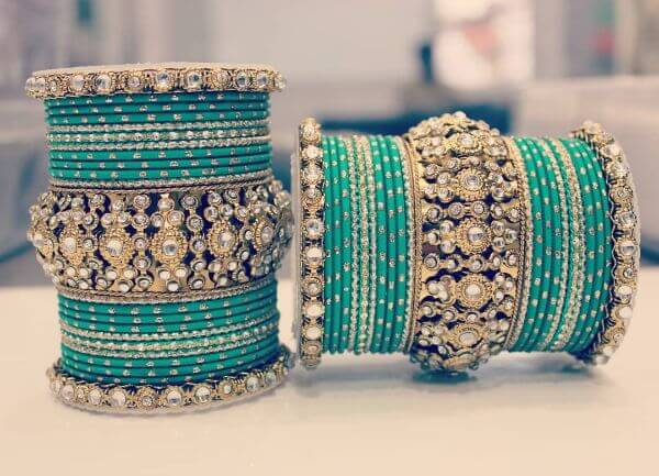 Green Indian bangles with gem based kadas Trendy Bangle Designs for Indian Brides to Make Your Wedding Memorable