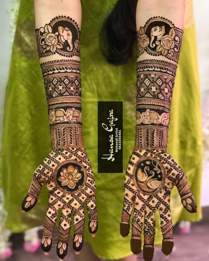Bridal Mehndi Designs for Full Hands . Elephants and lotus designer bridal mehndi design