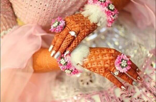 Soft pink fur and floral hathphool jewellery Floral Hathphool Jewellery Designs for Weddings