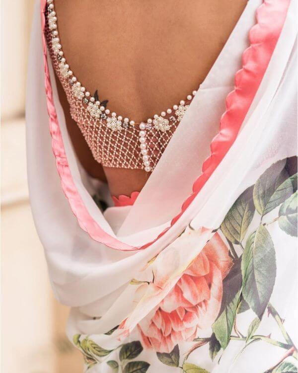 Beaded back net blouse design for bride