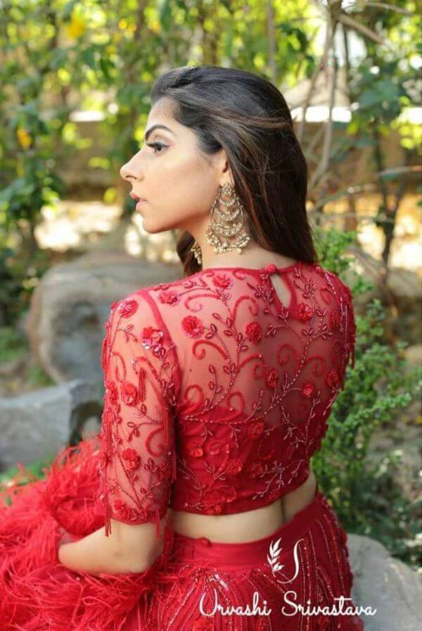 Net blouse with detailing of flowers in Red