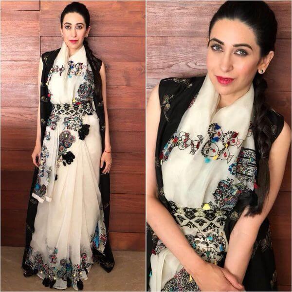 Karisma Kapoor wore a beautiful white saree with black jacket