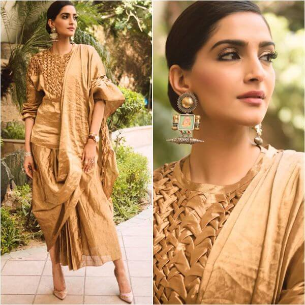 Sonam Kapoor golden wore a short Kurti with wore a skirt with some pleats in it and a dupatta