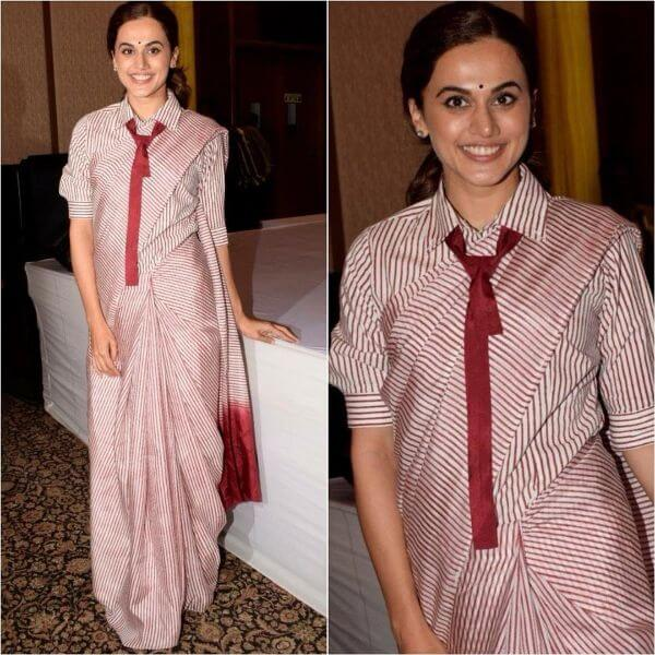 Taapsee was spotted wearing horizontal lining saree with a red tie on it