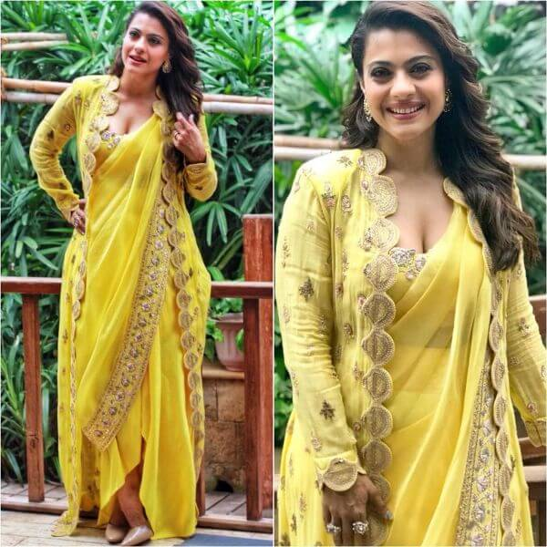 Kajol wearing a yellow pre stitched saree with long jacket matching with the saree