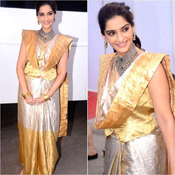 Sonam wore a golden and silver saree with a waist coat blouse on it