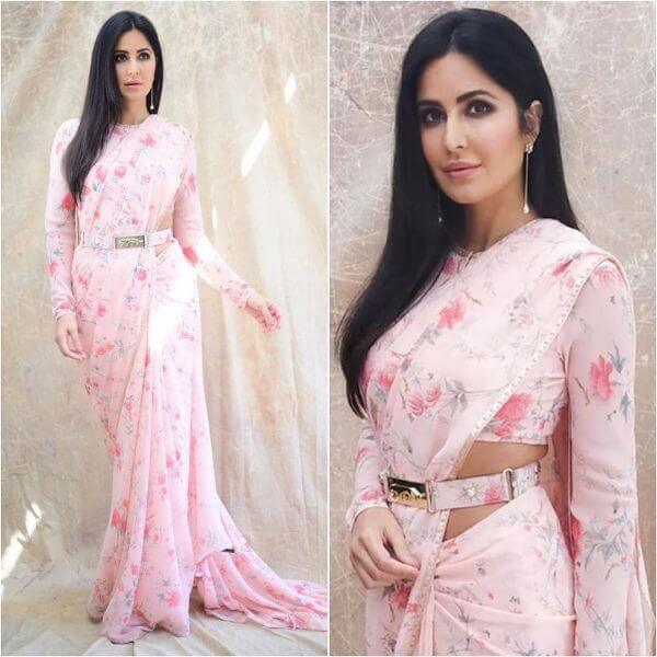 Katrina wearing a pink printed saree with matching belt over it.
