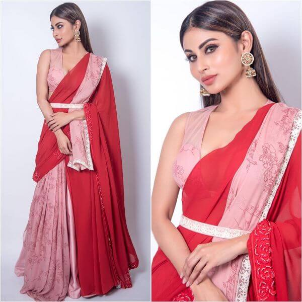 Mouni Roy wearing a pink and red saree draped in like a lehengas.
