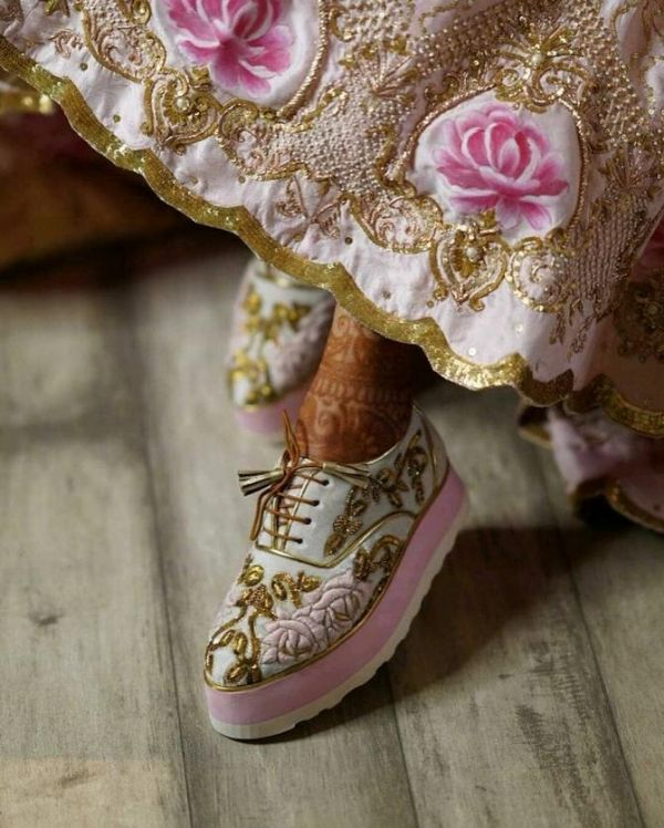 Plain white sport-style shoes and the ones with embroidery matching the wedding lehenga
