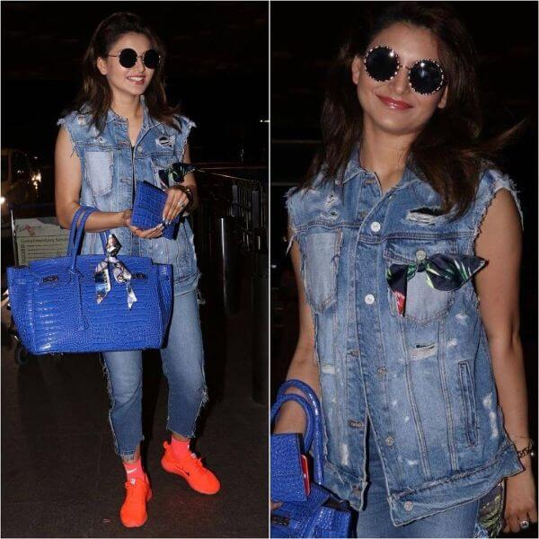 Uravshi Rautela airport looks consist of a denim jacket and a denim