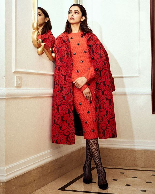 Deepika Padukone latest autumn/winter collection, paired it up with a Jacquard red coat, black shoes