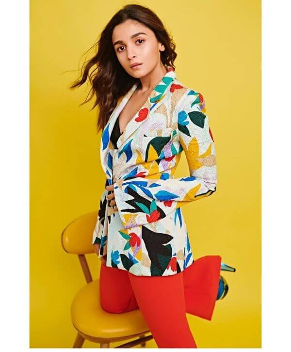 Alia Bhatt chose to go for a bold coloured Blazer with red hot Flared pants by Prabal Gurung