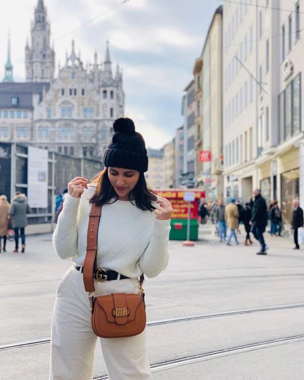 Parineeti Chopra plain white turtle neck sweater and white jeans , her Gucci Belt looks amazing