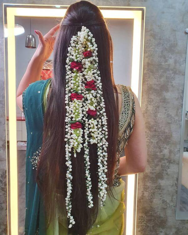 Open hairstyle with multiple Gajras for any ceremony