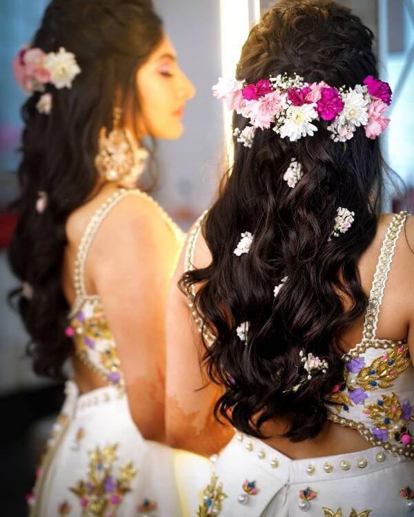 Clustered with baby's flower breath and romantic curls