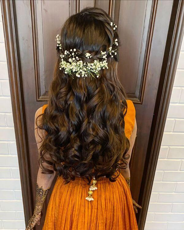 Overall crown braid tucked with baby's breath for festive season