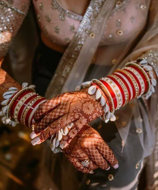 Traditional red shell and ivory choodas Latest Chooda Designs for Brides to Try in 2020