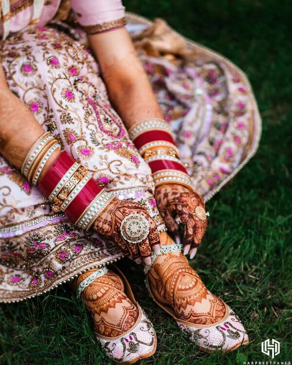 Hot pink choodas with ivory designs for brides