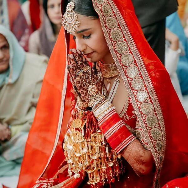 Miss India Earth Hasleen chose proper red choodas and added kaleeras for her wedding