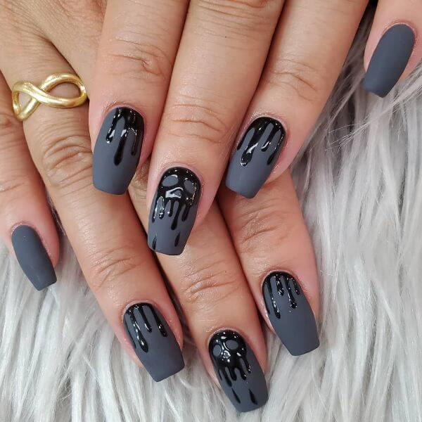 Grey matte nailpaint with black skull gel melted over the top for halloween