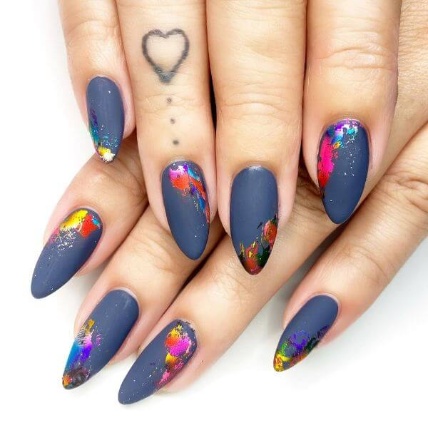 Navy blue matte nail paint with small paintings on it nail art for girls